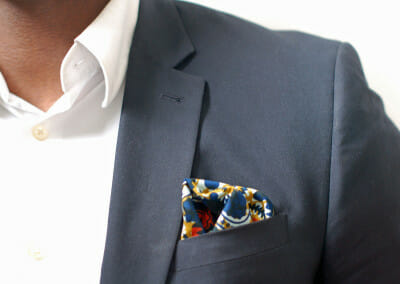grey-suit-blue-orange-square