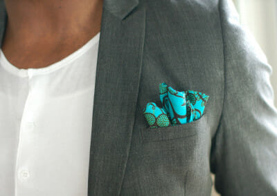 grey-suit-teal-square